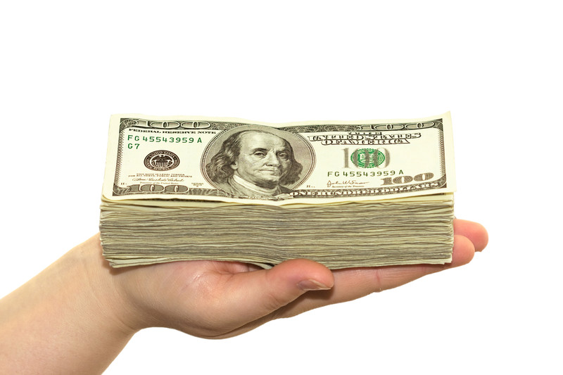 (c) Can Stock Photo_ money on hand+funding